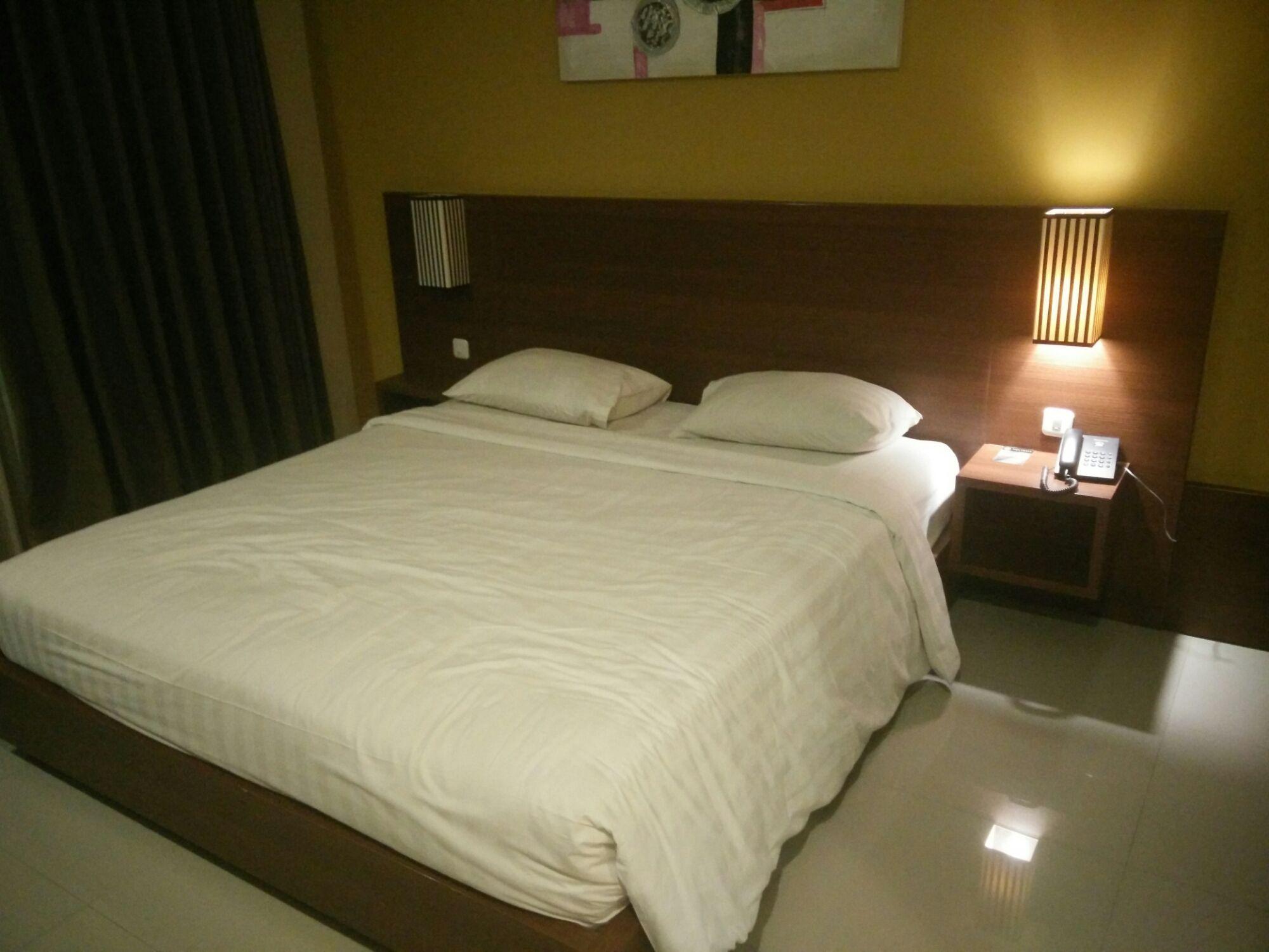 Cama doble king size en Hotel Bali Chaya